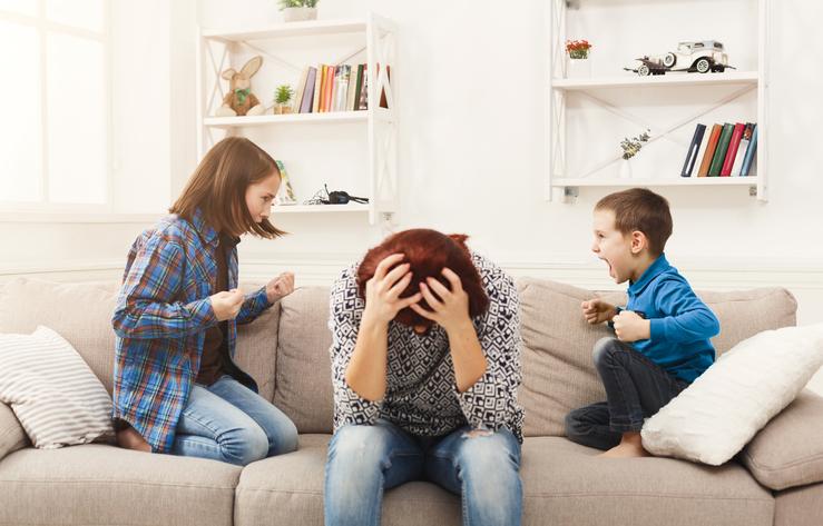 Stressedmotherwithtwokidsquarreling